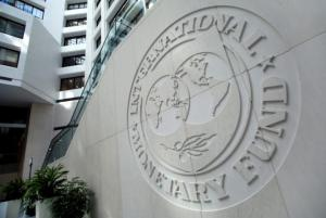 The International Monetary Fund logo is seen inside its headquarters at the end of the IMF/World Bank annual meetings in Washington