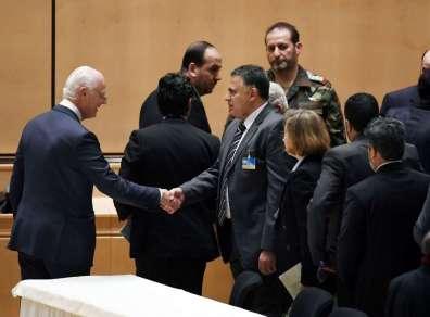 U.N. Syria envoy Staffan de Mistura greets opposition negotiators at the talks in Geneva.