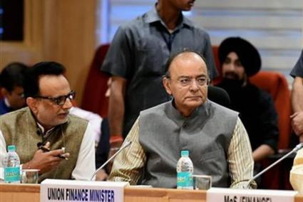 Finance minister Arun Jaitley (right) during the GST council meeting at Vigyan Bhawan in New Delhi on Saturday. Photo: PTI